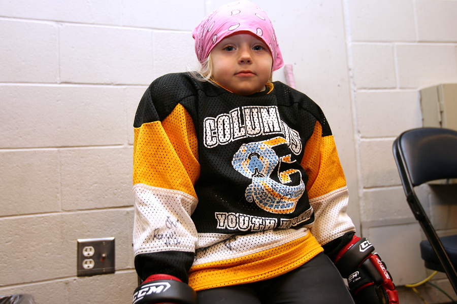 A four-year-old skater waits for her turn to hit the ice.