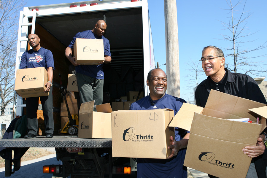 Former NBA players Mike Glenn and Jim Washington unload boxes of books for the donation to the shelter.
