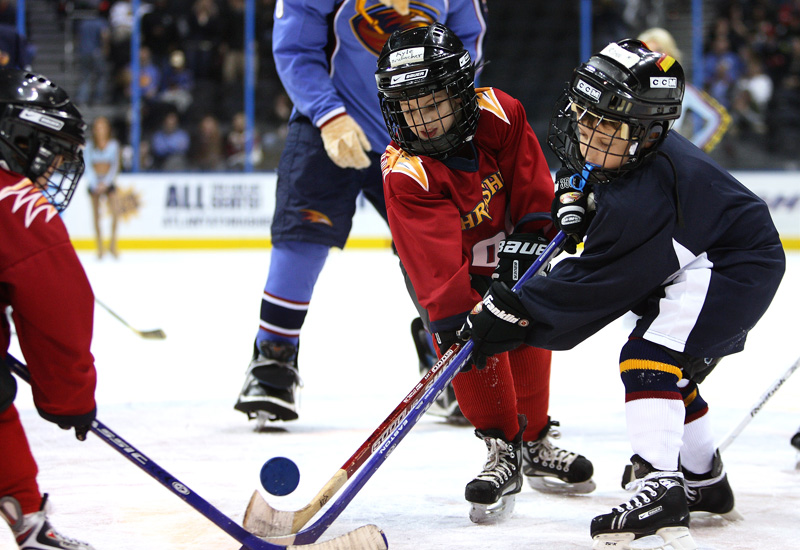 Kids go after the puck as they play at Philips Arena during the cross-ice contest.